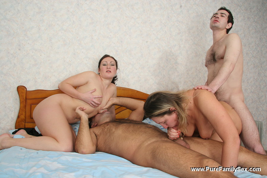 image Lucky white stud gets his throbbing cock deepthroated by two black whores